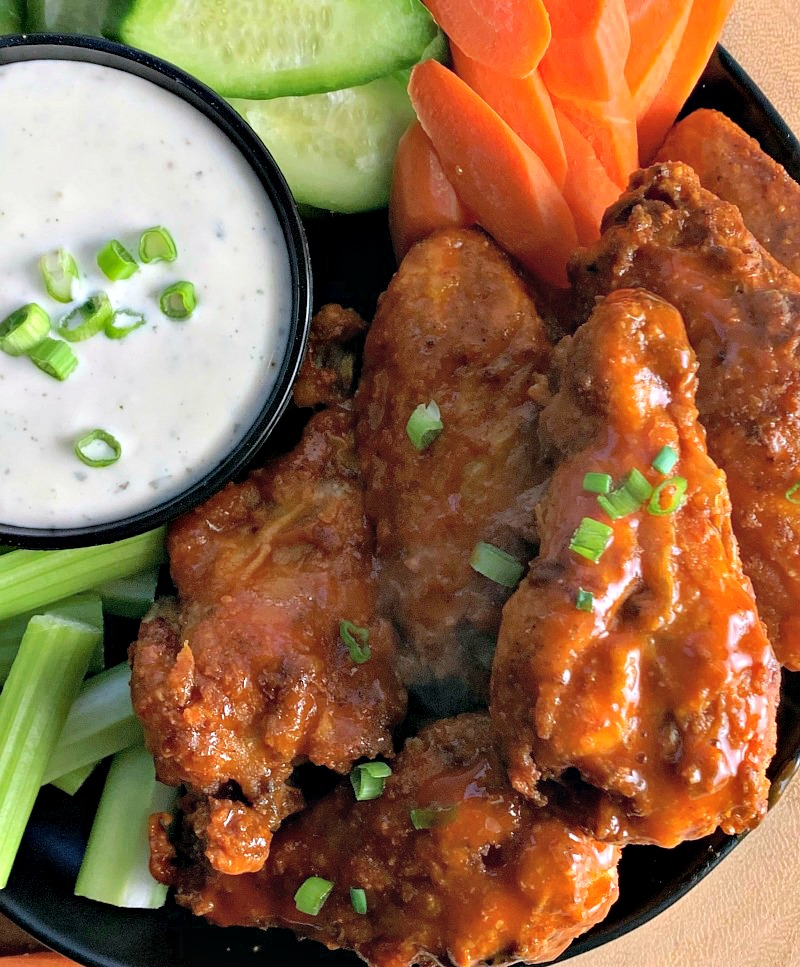 plate of air fryer chicken wings with ranch for dipping