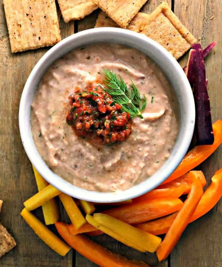 Black Eyed Pea Hummus ~ simple, healthy, creamy black eyed pea hummus topped with a dollop of tomato chow chow relish. Eating black eyed peas New Year's Day is said to bring luck all year.