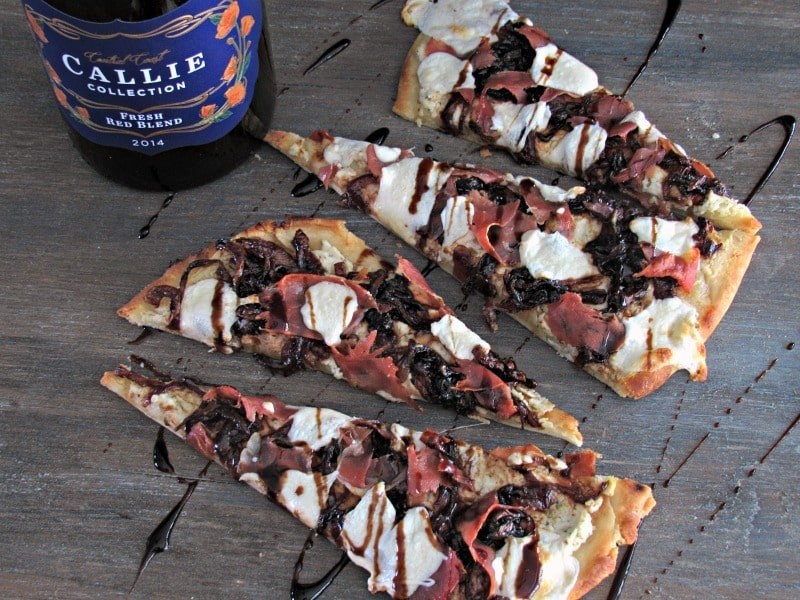 Caramelized Onion Goat Cheese Pizza with a balsamic glaze and Callie Collection Wines for easy entertaining with friends and moments that stop time.