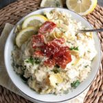 Do you want to know the 1 ingredient for the creamiest risotto ever? Artichoke Lemon Risotto has it + tips for EASY, PERFECT risotto every time.