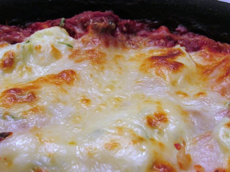 Easy Skillet Lasagna - cheesy, tomatoey, decadent made all in one skillet. Serves 2 or generously serves 1 with enviable lunch leftovers.