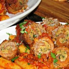 plate of beef braciole and pasta