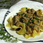 The Best Beef Stroganoff ~ tender beef simmered in a delicious sour cream/mushroom sauce with fresh herbs and a hint of Dijon mustard all over egg noodles.