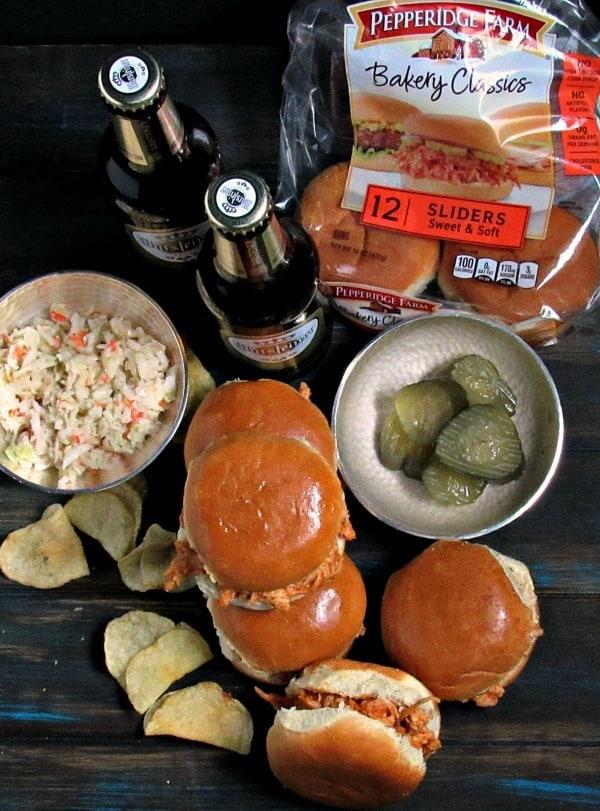 Beer Braised Chicken Sliders ~ juicy, tender beer braised chicken shredded and tossed in a mildly spicy sauce served on slider buns.