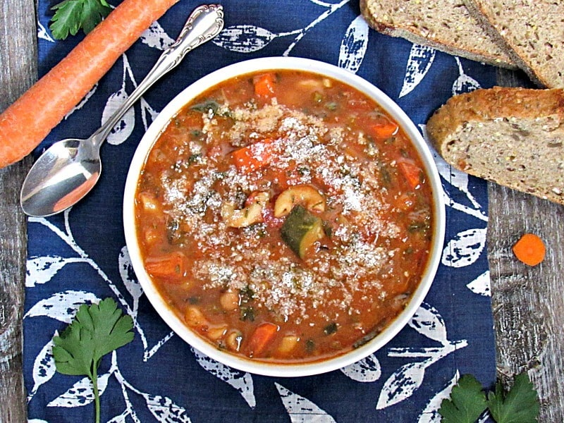 Tomato White Bean Soup: thick tomatoey broth infused with herbs and packed with beans and vegetables including superfood spinach.