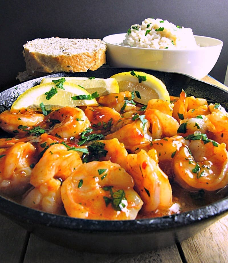 Spicy New Orleans Style Shrimp: easy, tasty shrimp in a rich, spicy buttery Cajun sauce. Serve over rice or with crusty bread.