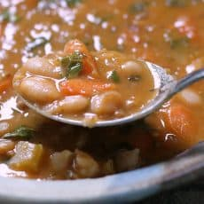 bean with bacon soup ~ bowl of soup with spoonful showing close up of beans.