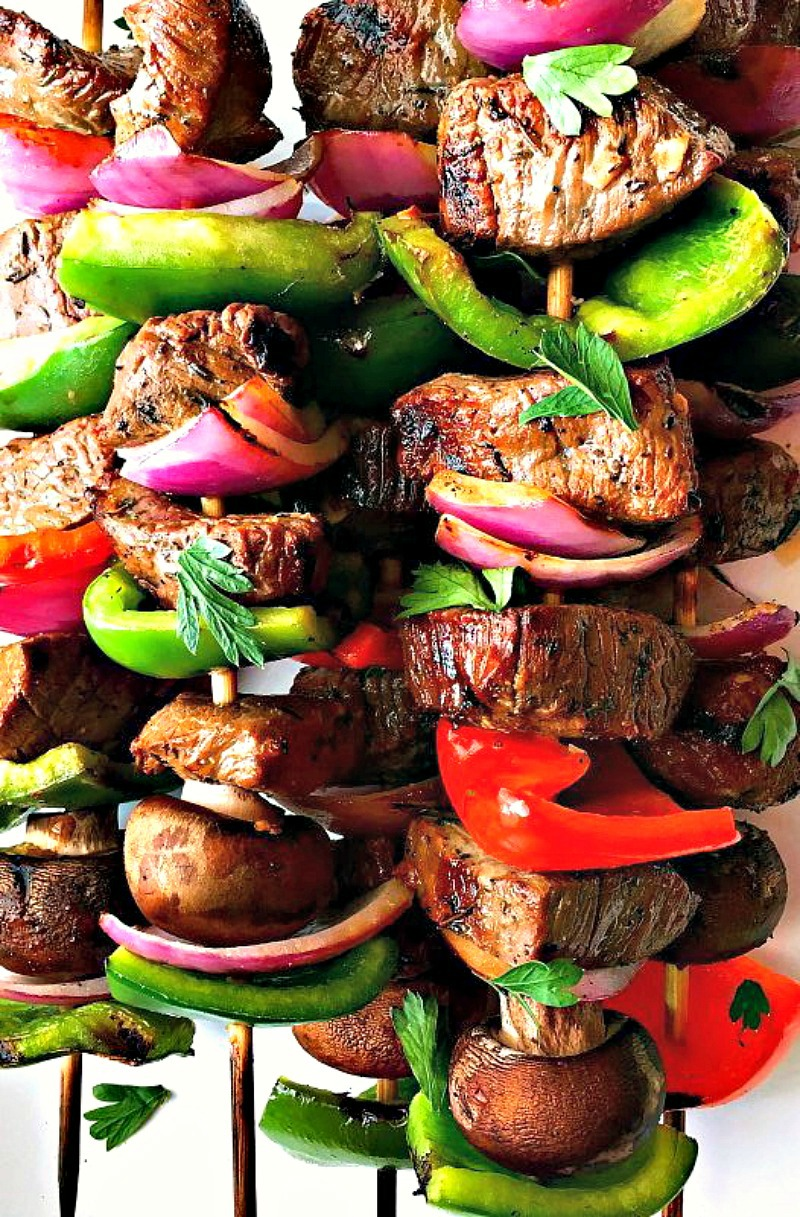 grilled kabob skewers with bright vegetables and beef