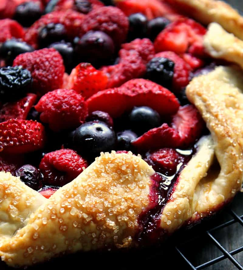 close up of berry galette showing golden crust baked with coarse sugar