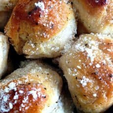 Skillet Garlic Herb Biscuits ~ freshly baked bread, smothered in garlic-y butter and topped with cheese. Serve as an appetizer or with pasta, soup or steak.
