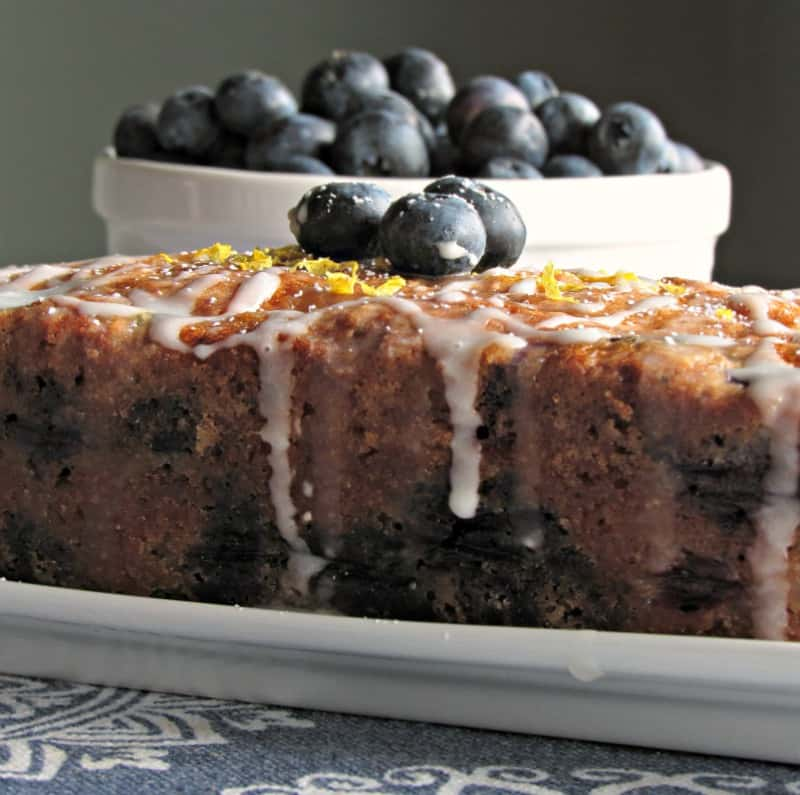 Lemon Blueberry Zucchini Bread ~ easy, moist, blueberry packed quick bread, made with shredded zucchini and yogurt, drizzled with lemony glaze.