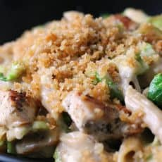 cheesy chicken pasta with brussels sprouts ~ pan seared chicken and brussels sprouts in a creamy, cheesy sauce topped with toasted bread crumbs.