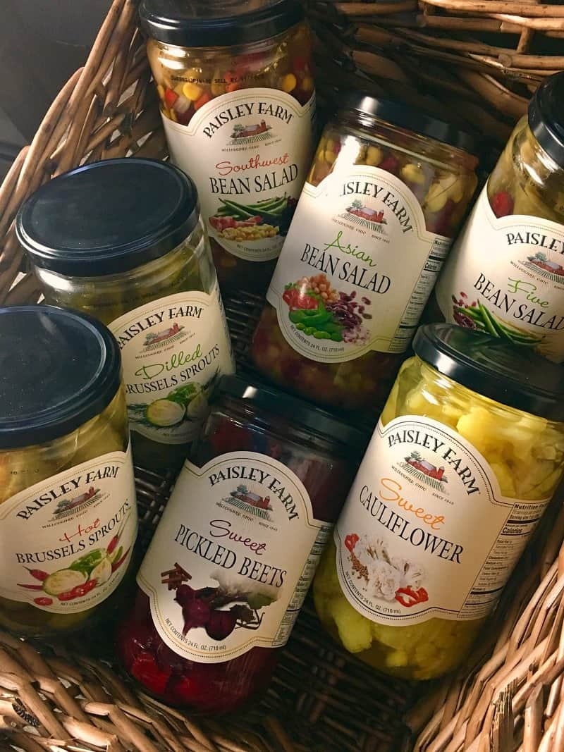 brussels sprouts soup recipe ~ overhead view of variety of Paisley Farm jars in a basket.