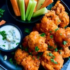 buffalo cauliflower bites served with ranch, carrots and celery