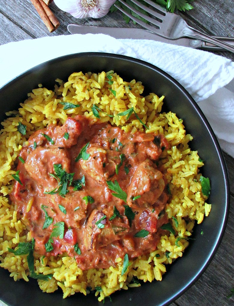 overhead butter chicken recipe served with yellow jasmine rice