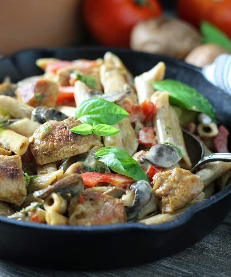 creamy cajun chicken pasta ~ cajun seasoned chicken bites, penne pasta, mushrooms, bell peppers in a creamy spicy alfredo sauce.