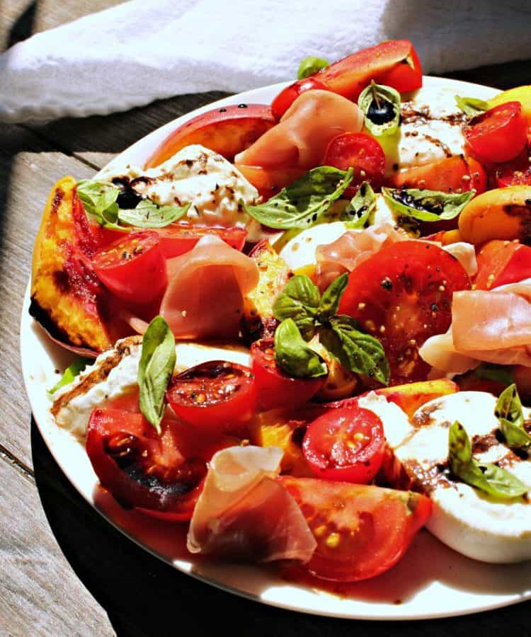 Grilled Peach Caprese ~ grilled sweet peaches, summer tomatoes, fresh mozzarella or burrata, salty prosciutto, basil and balsamic reduction.