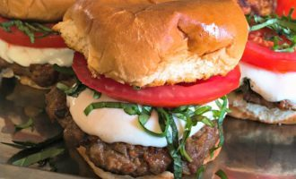 Caprese Slider - two summer favorites - specially seasoned grilled burgers and caprese salad all between a delicious grilled bun.