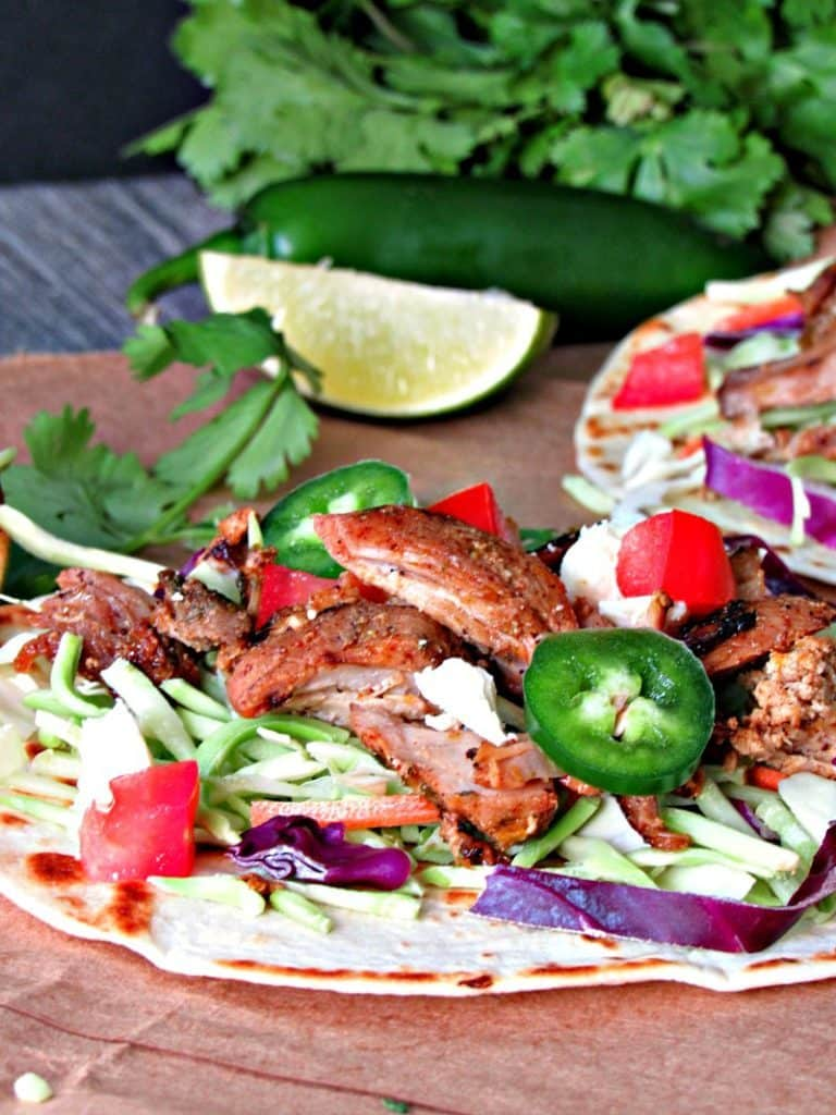 Slow Cooker Pork Carnitas: juicy, tender pork with brown, flavor-packed edges. Enjoy as tacos, burritos, enchiladas or all by itself.