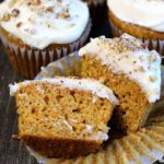 carrot cake cupcakes ~ cream cheese frosted cupcakes and view of one cupcake cut in half showing inside.