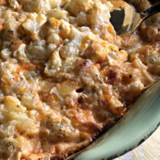 Cheesy Baked Cauliflower ~ tender cauliflower baked in a creamy cheese sauce. All the decadence of mac and cheese, with the health benefits of veggies.