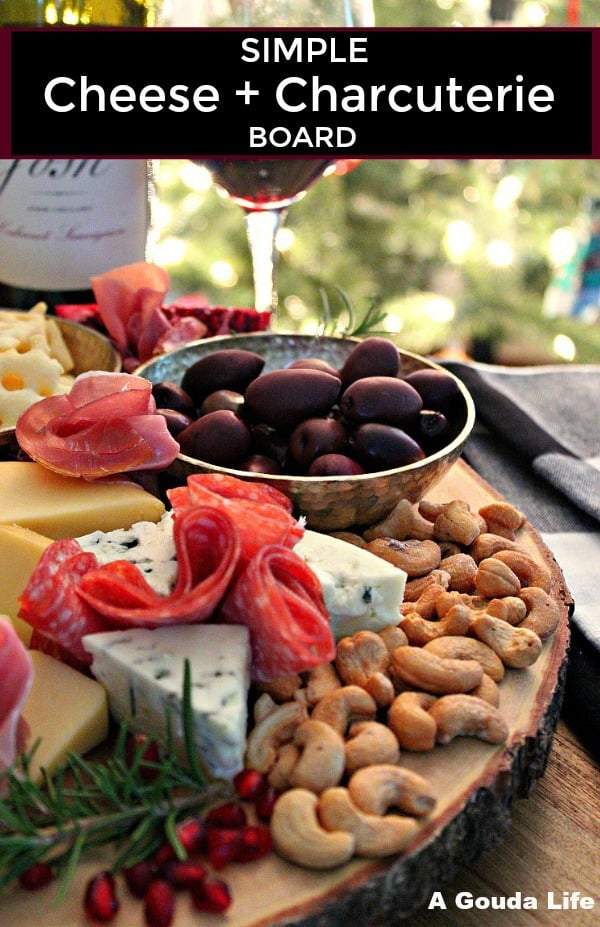 cheese and charcuterie board ~ pinterest pin - overhead view of the board with all meats and cheeses