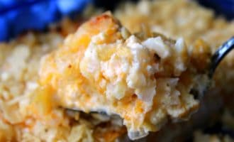 closeup scoop of cheesy potatoes