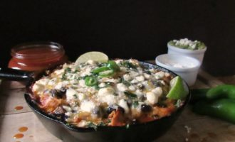 One Pan Chicken Enchilada Casserole. Flavored chicken, beans and tortillas layered and topped with cheese. Weeknight or + margaritas for easy entertaining!