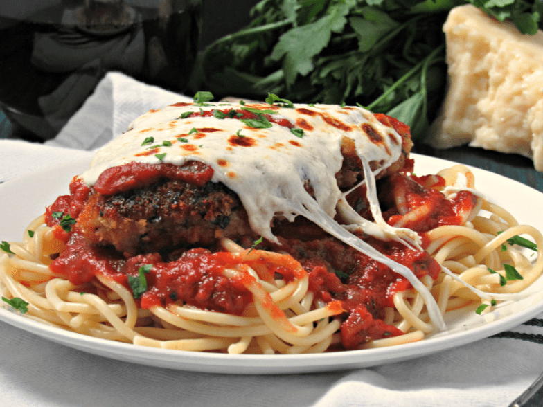 Chicken Parmesan ~ crispy breaded chicken cutlets smothered in mozzarella cheese and baked in a homemade marinara all over thin spaghetti.