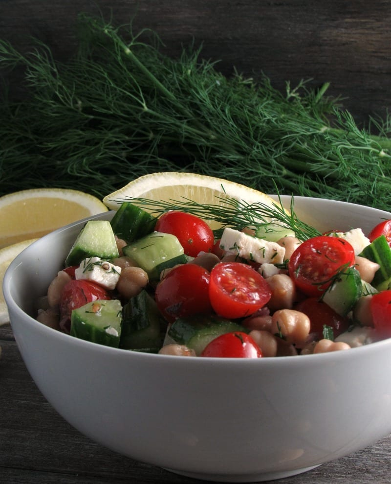 Chickpea Tomato Cucumber Salad whips up in under 10 minutes with tasty flavors and a light lemon dressing! Great side dish or lunch.
