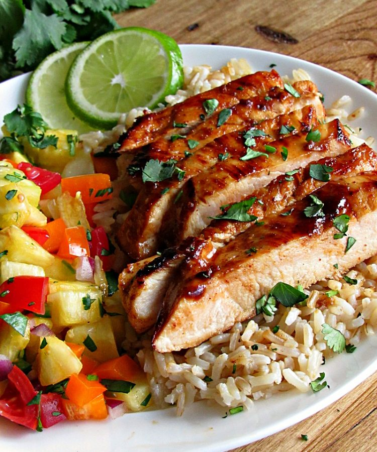 Chili Lime Chicken ~ tender, juicy chicken breasts exploding with bold flavor, topped with an easy sweet-spicy fresh pineapple salsa. Stove to table in under 30 minutes!