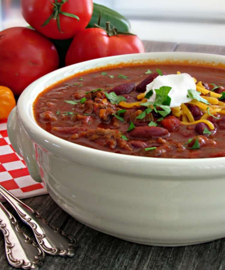 Easy Spicy Beef Chili ~ loaded with beef, beans and packs just right amount of heat + 3 secret ingredients that take this chili to the next level.