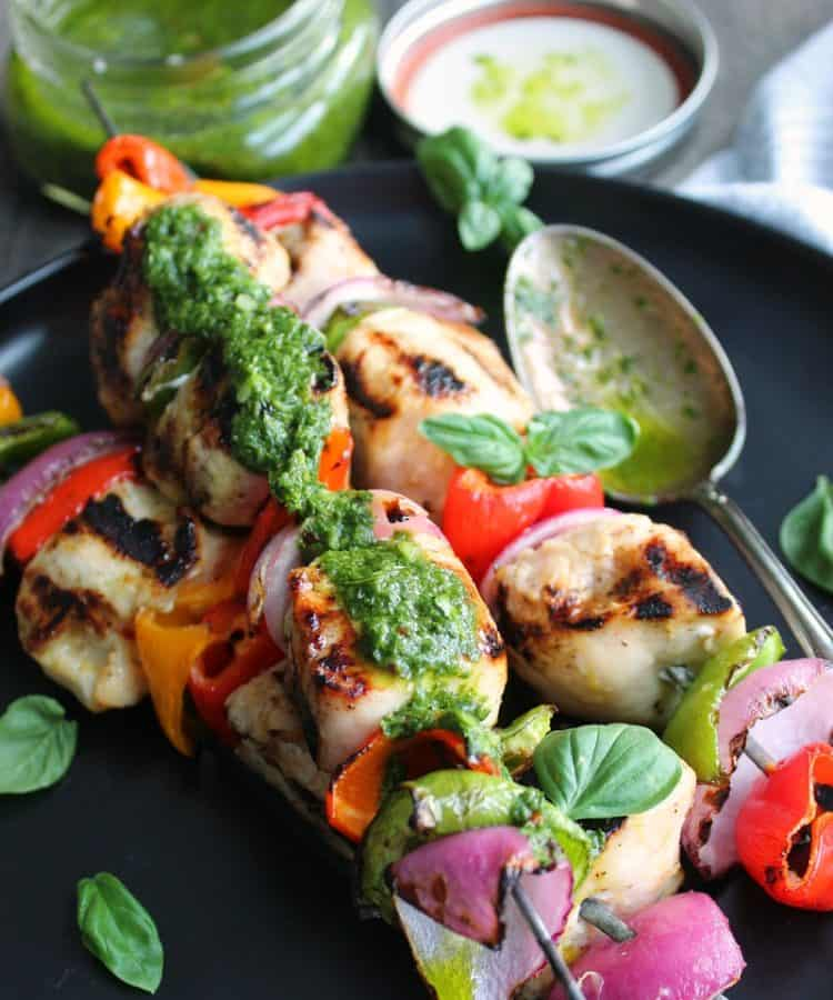 grilled chicken skewers with basil chimichurri drizzled over top