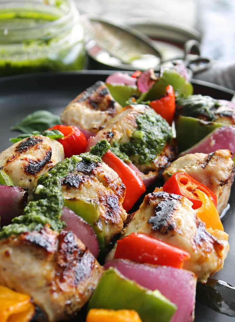 grilled chicken skewers with basil chimichurri drizzle on top