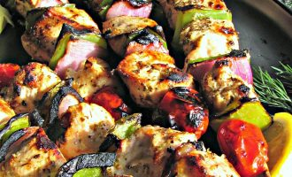 Grilled Lemon Garlic Chicken Kabobs ~ marinated chicken, bright colored bell peppers and red onions skewered then grilled to golden, garnished with lemon wedges and served with pita bread.