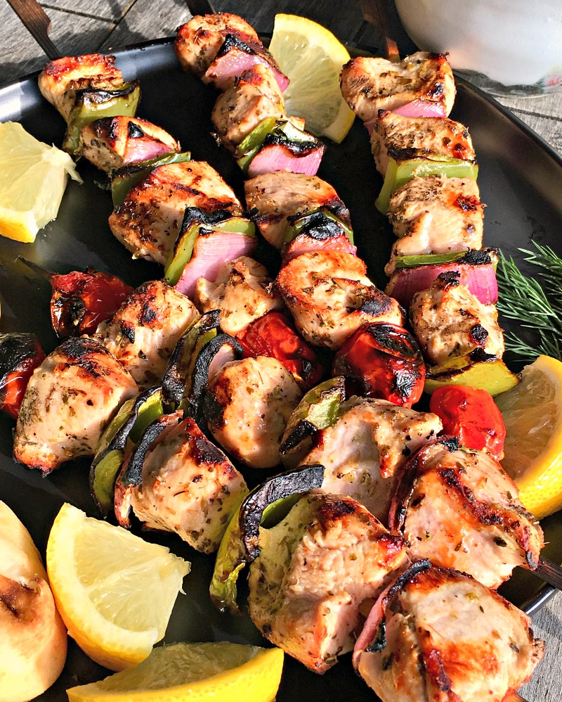 Grilled Lemon Garlic Chicken Kabobs ~ grilled chicken cubes skewered with bright colored bell peppers and onions, garnished with lemon wedges.