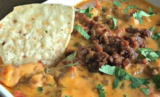 Chorizo Queso Dip ~ warm, creamy cheese, bites of spicy chorizo & tomatoes plus fresh cilantro and a squeeze of lime juice. Serve with warm tortilla chips.