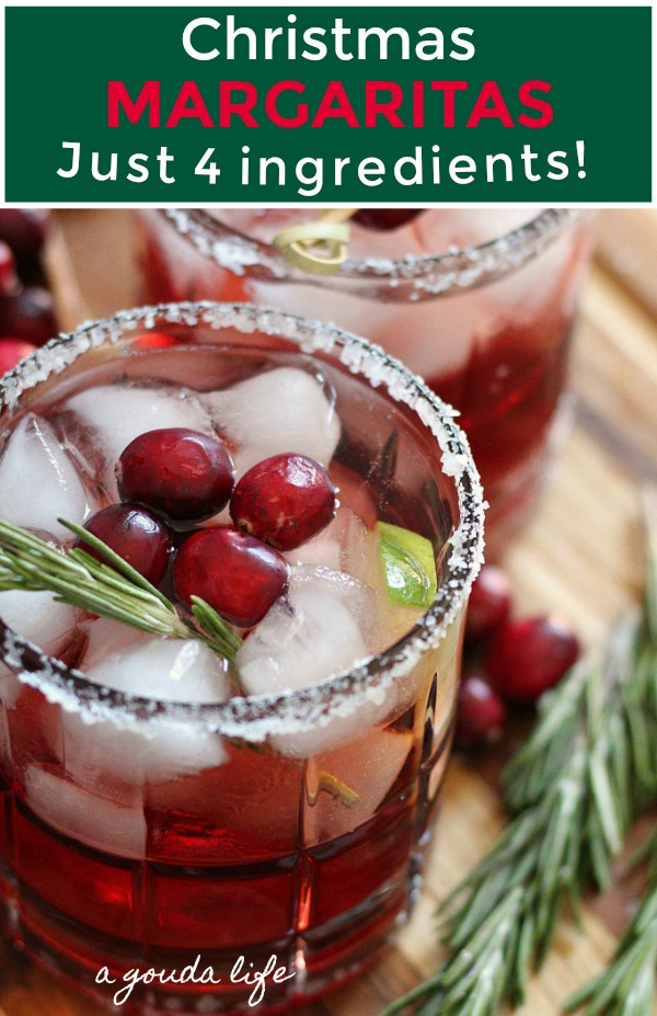 pinterest pin showing 2 christmas margaritas garnished with fresh ranberries