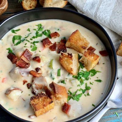 black bowl of easy clam chowder, new england style