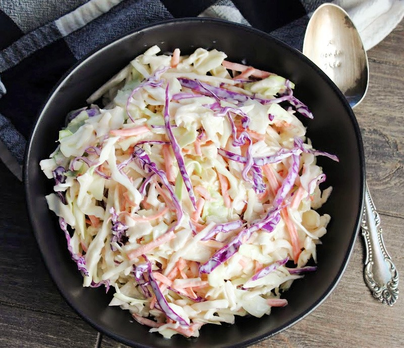 overhead view - black bowl with creamy coleslaw