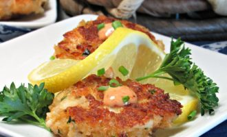 Mini Crab Cake Appetizer ~ gently golden crisp outside, lumps of tasty crab inside with a little dollop of Horseradish sauce on top.
