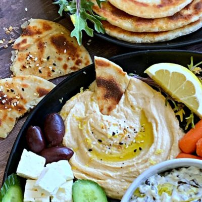 2 Ingredient Dough made into naan bread shown on Greek appetizer platter