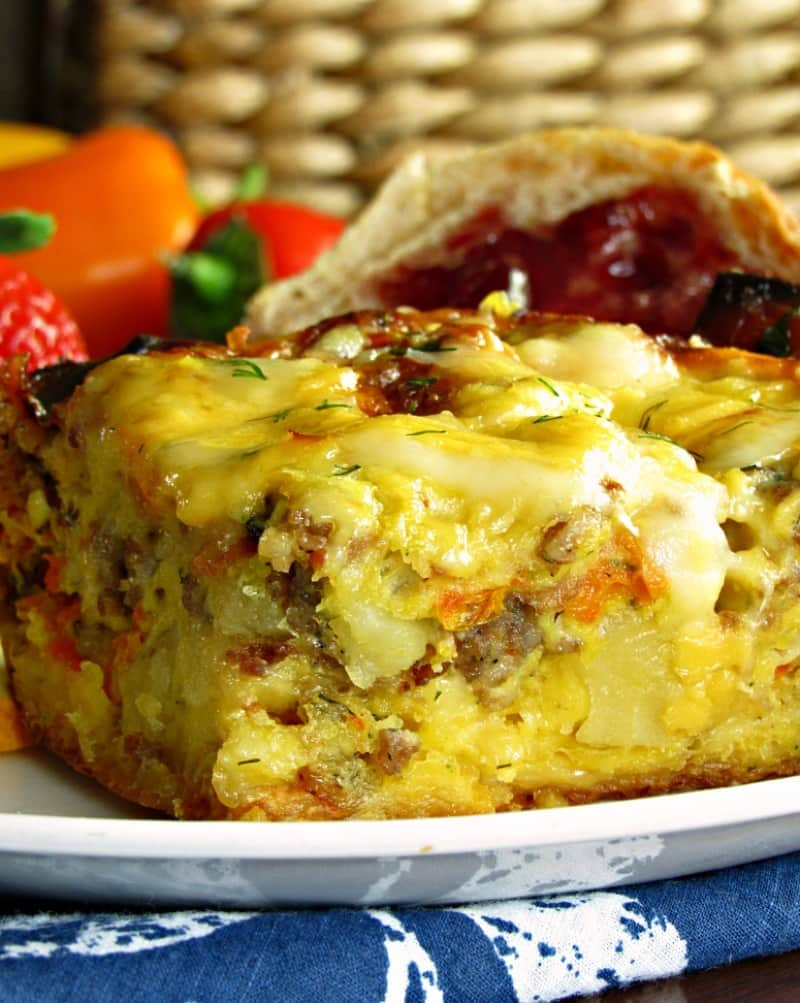 Overnight Breakfast Egg Sausage Casserole: eggs, sausage, 3 kinds of cheese and fresh herbs. Prep the night before for an easy morning.