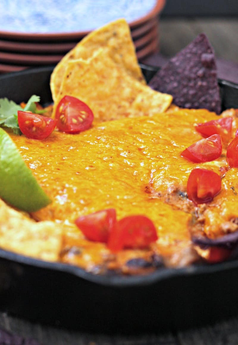 Beef Enchilada Dip ~ spicy ground beef + cheese, black beans, tomatoes, green chilies and enchilada sauce, topped with more cheese and baked 'til bubbly.