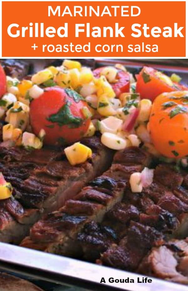 sliced flank steak topped with bright corn salsa