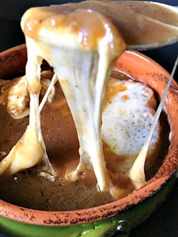 French Onion Soup ~ rich, flavorful broth, caramelized onions, topped with toasted bread and creamy Provolone cheese then broiled until brown and bubbly.
