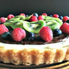 fruit tart recipe ~ sugar cookie crust layered with cheesecake filling, nutella and finished with fresh fruit.