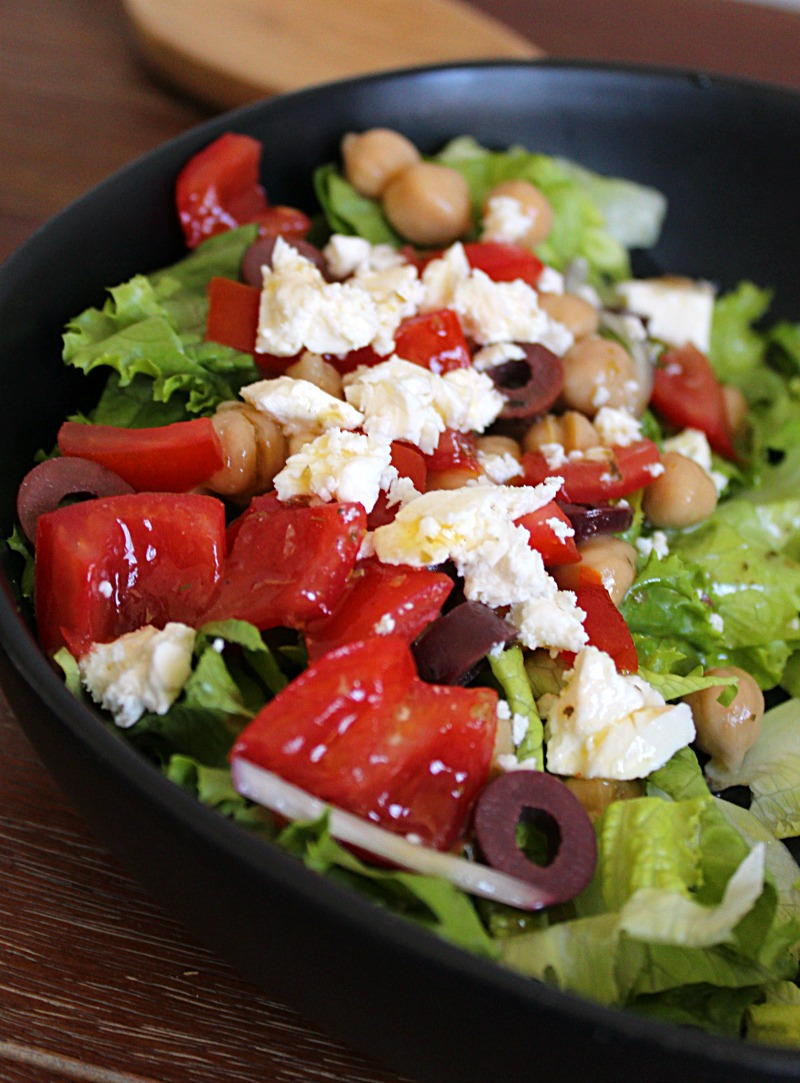 greek salad drizzled with greek salad dressing
