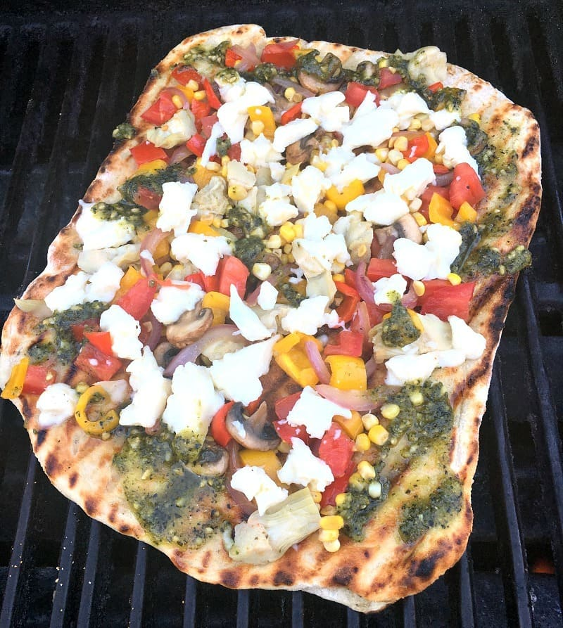 Learn How to Grill Pizza at home ~ thin, lightly crispy-charred tastes like wood-fired from your favorite restaurant, topped with all your favorites.
