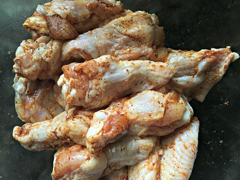 Easy Grilled Spicy Chicken Wings with a sweet-spicy Jack Daniels sauce. Don't let summer pass without making this one! Easily adapts from two to a crowd!